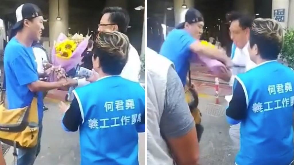 Planting seed: 'Supporter' with flowers approaches Mr Ho and then stabs the politician in his chest