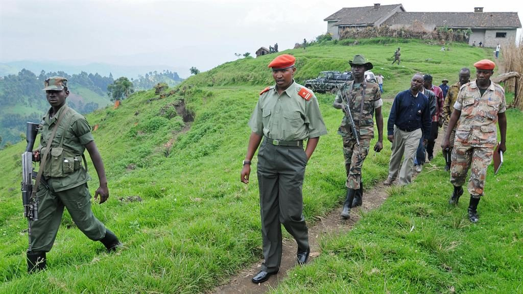 Rebel leader: Bosco Ntaganda escorted by troops at his base in Kabati in 2009 PICTURE: GETTY