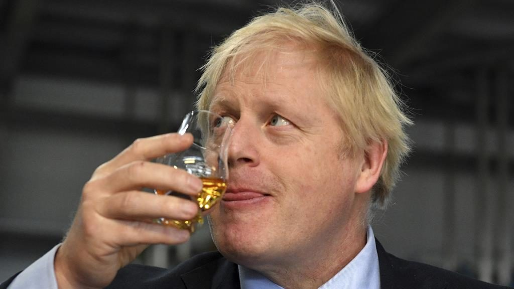 Get Brexit dram: Boris Johnson at a whisky distillery in Scotland yesterday PICTURE: AP