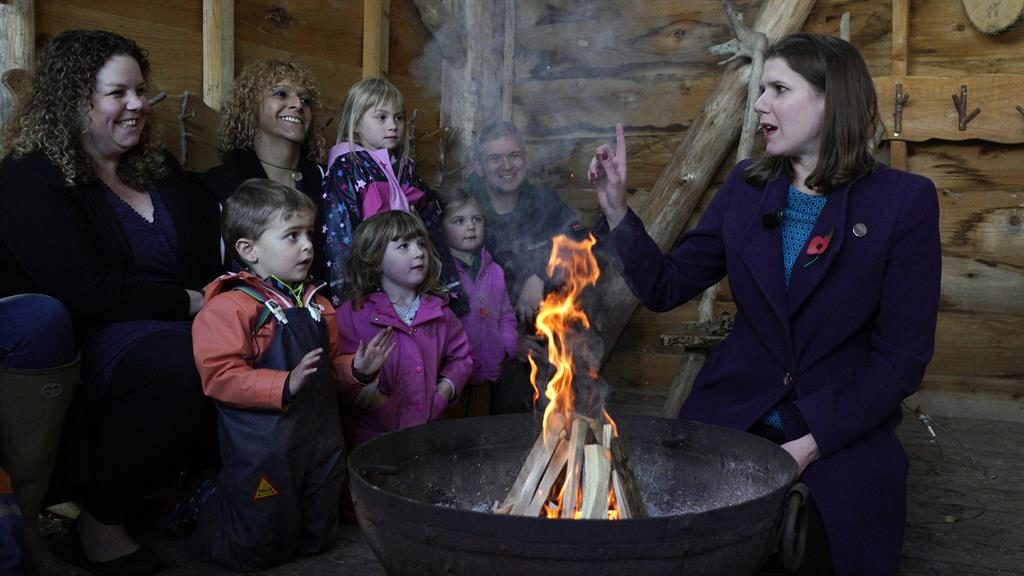Warm reception: Jo Swinson at a nursery in Somerset where she toasted marshmallows (below) PICTURES: EPA