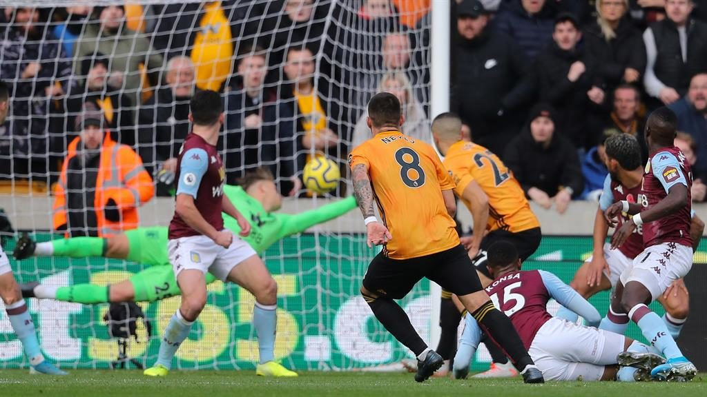 Derby delight: Neves fires Wolves ahead at Molineu PICTURE: GETTY