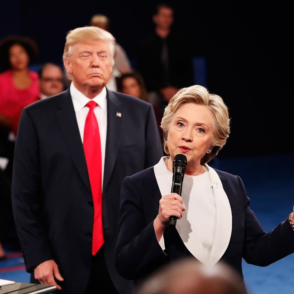 Space invader: Donald Trump stands behind Hillary Clinton during their televised debate, and (below) the former First Lady at London's Southbank Centre on Sunday PICTURES: PA/GETTY