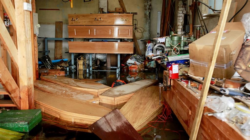 Adrift: Coffins swept from stands in parlour after the Don burst its banks, ruining homes and businesses PICTURES: SWNS/CHRIS NEILL