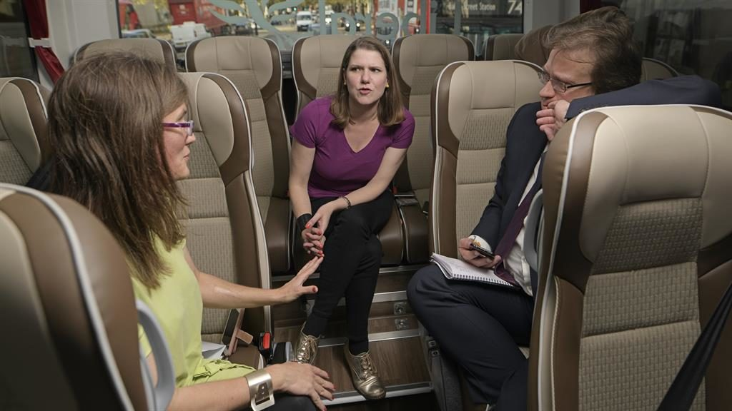 Bus seat of power: Jo Swinson chats to Sharon Lougher and Joel Taylor on the campaign coach PICTURES: DANIEL LYNCH