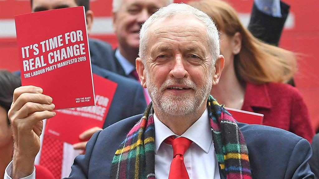 'Real change': Labour leader Jeremy Corbyn holds up his party's manifesto
