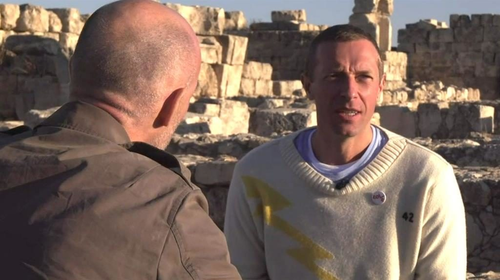 Tour ban: Chris Martin being interviewed by the BBC's Colin Paterson in Jordan yesterday