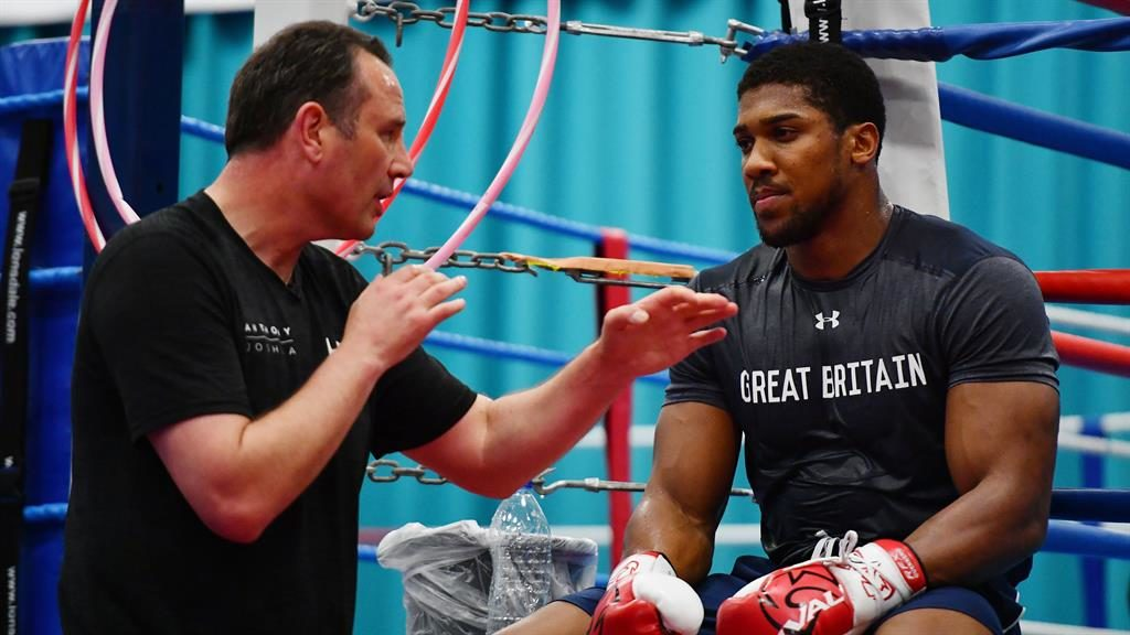 Best of intentions: Joshua and his trainer McCracken PICTURE: GETTY