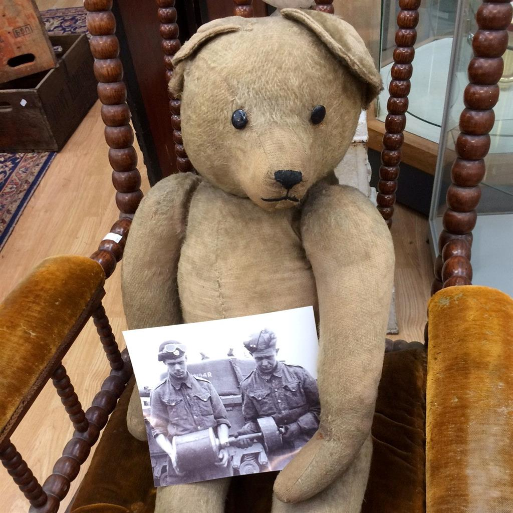 Up for auction: The bear with a World War II photo of Mr Matthews Snr (on the left) PICTURE: SWNS