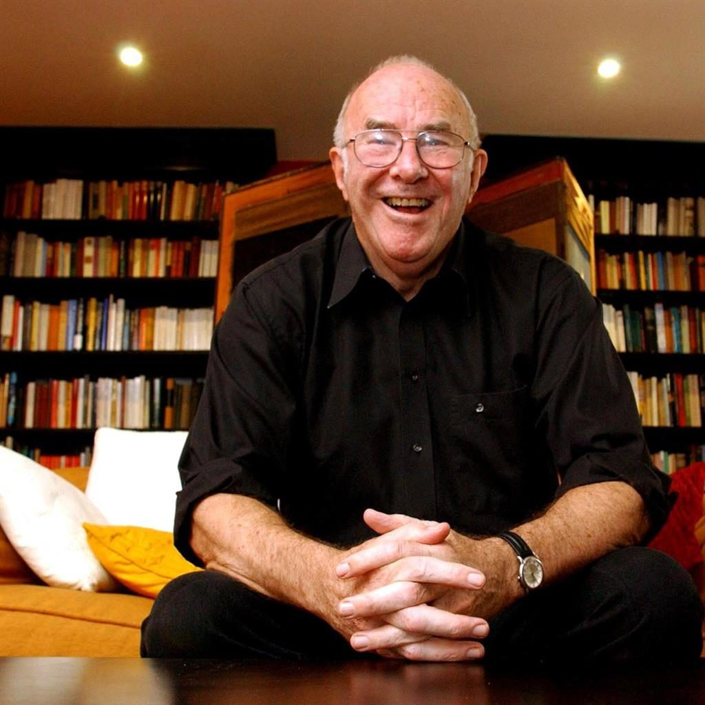 Well read: Clive James at home surrounded by books in 2006. His agents said he kept his sense of humour throughout his long illness PICTURE: REX