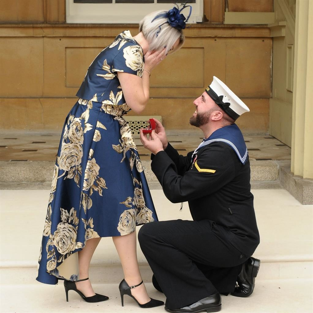 On bended knee: Matthew proposes to partner Adele at the Palace PICTURE: PA