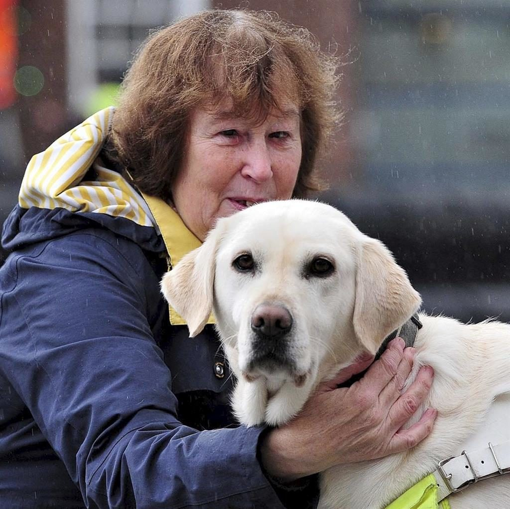 Refused: Ms Chandler with guide dog Sally PICTURE: SWNS