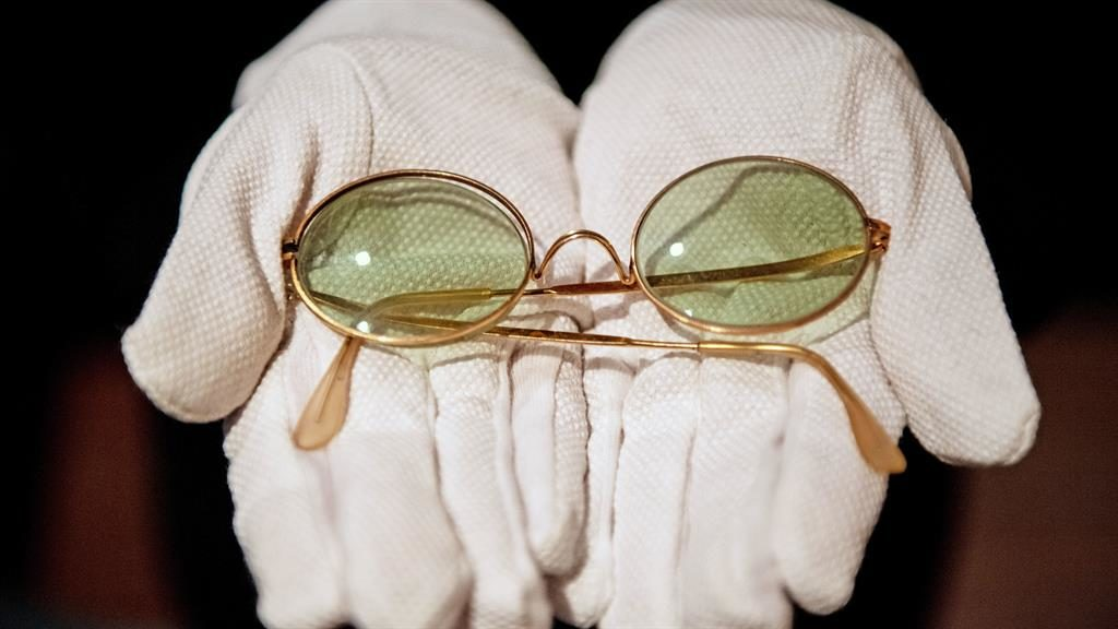 Beatles for sale: John Lennon's trademark sunglasses are expected to fetch £8,000 PICTURES:PA/REX