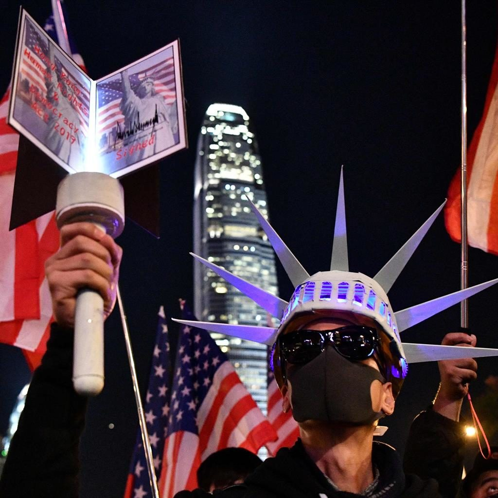 Friends in the West: An activist in Hong Kong dresses as the Statue of Liberty PICTURE: GETTY