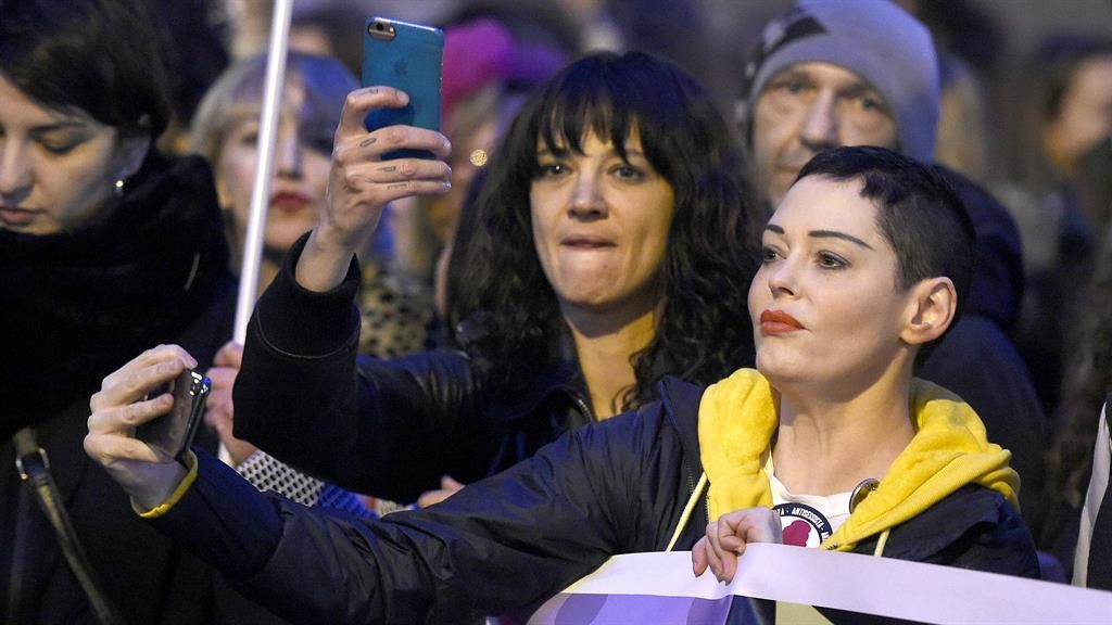 Rallying cry: Asia Argento and Rose McGowan at a #MeToo march in Rome, in 2018 PICTURE: REX