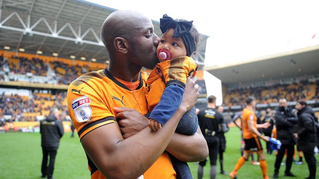 Love: Benik Afobe kisses daughter Amora after helping Wolves gain promotion in 2018 PICTURE: CAMERASPORT