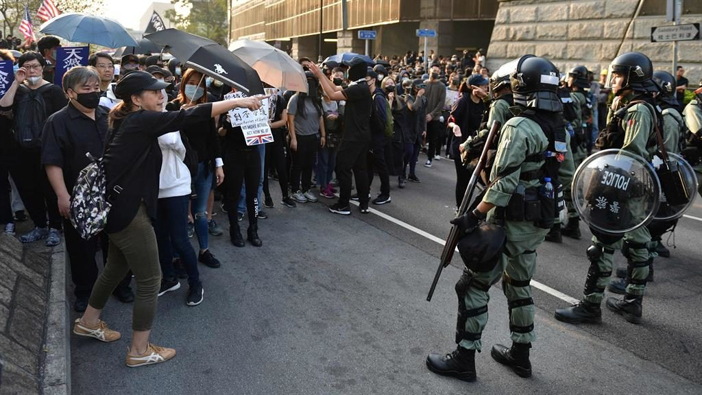 Stand-off: A crowd of activists and riot police square up to each other PICTURE: GETTY
