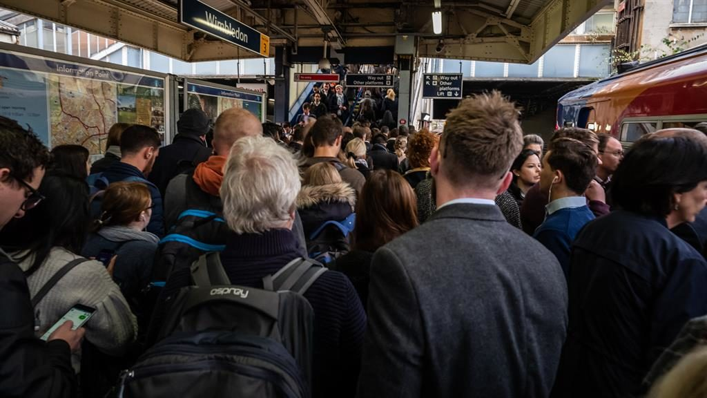 Rail delays: Commuters at Wimbledon during a previous strike