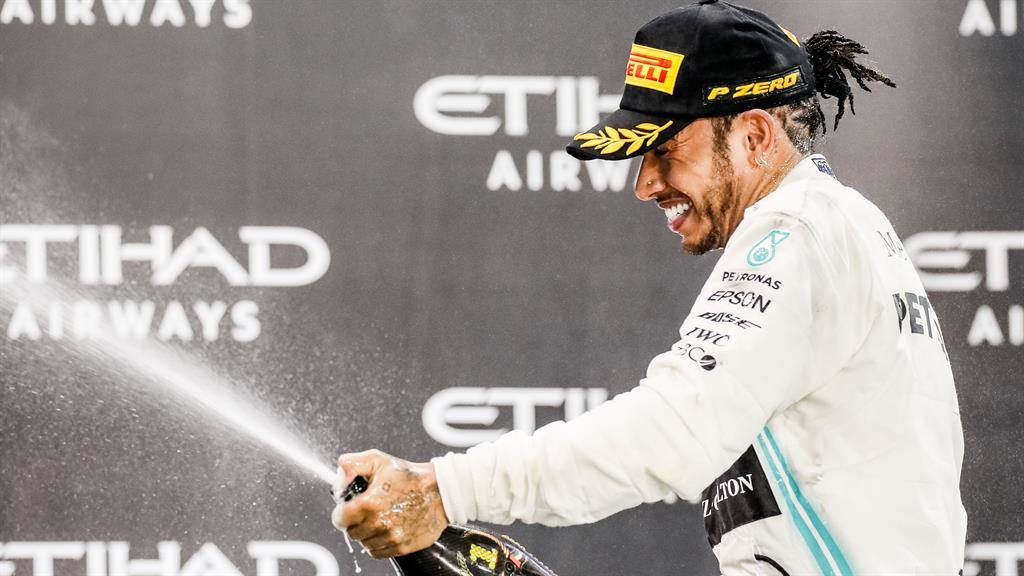 Ferrari bound? Lewis Hamilton sprays the champagne after winning his 11th race of the year yesterday