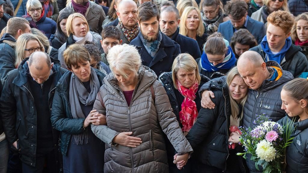 Mourning: Leanne O'Brien (front, third-right), the girlfriend of Jack Merritt, is comforted by family members during a vigil at The Guildhall in Cambridge to honour both him and Saskia Jones PICTURES: PA