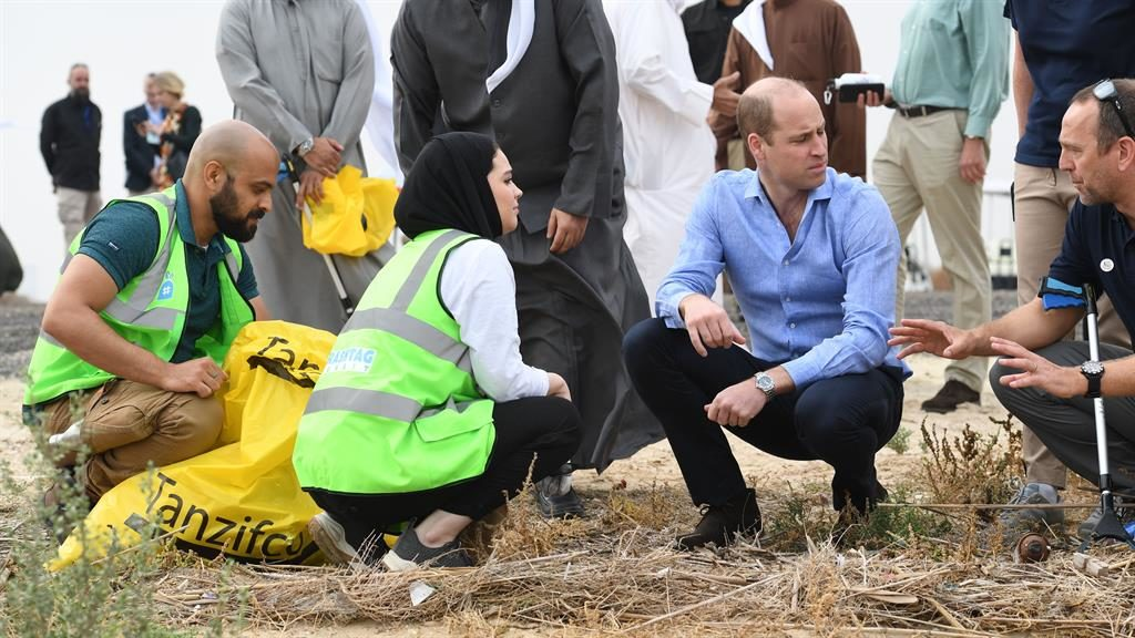 Trash talk: Prince William chats to volunteers at Jahra nature reserve PICTURE: TIM ROOKE/REX