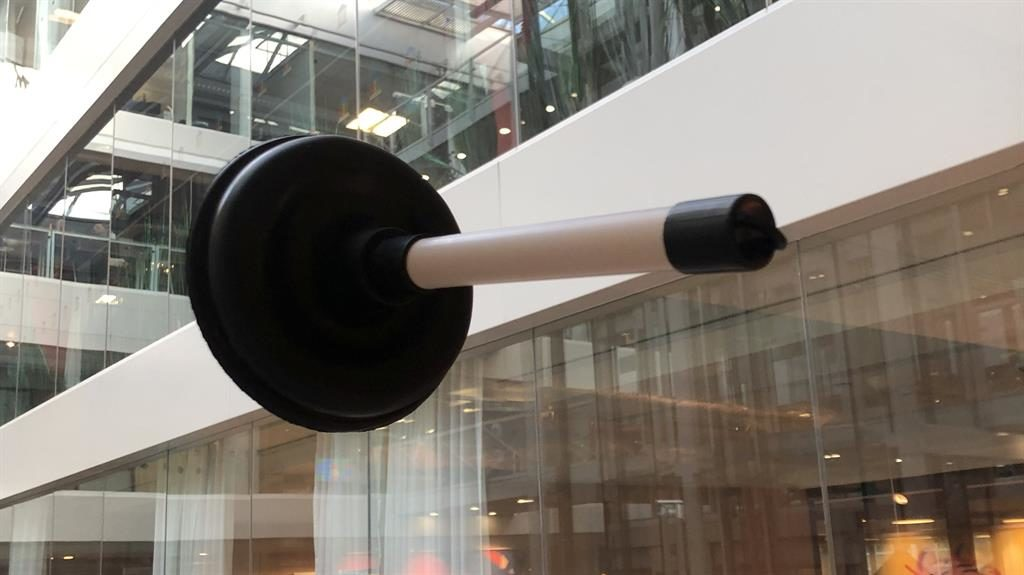 Loodunnit? John Browne was sent this plunger instead of an Apple Watch PICTURES: SWNS