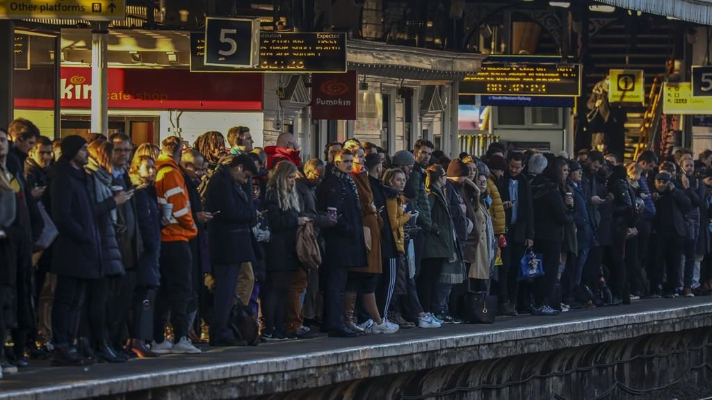 Stuck in the middle: Commuters at Clapham Junction in south London yesterday PICTURES: LNP