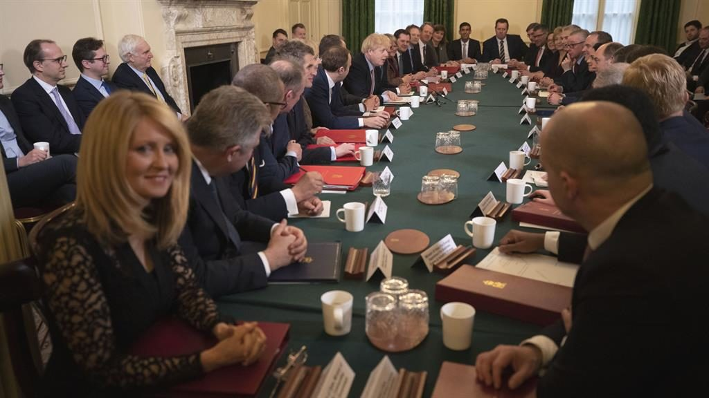 Top table: Housing minister Esther McVey smiles at camera as PM gives pep talk PICTURE: AP