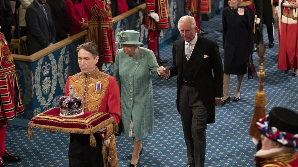 A steady hand: The Queen and Prince Charles walk through the Royal Gallery PICTURE: AP