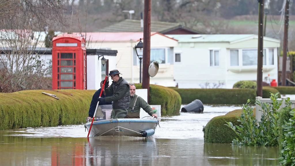 Taking a punt: Residents of Little Venice Caravan Park in Yalding, Kent, are rescued by boat  PICTURE: PA