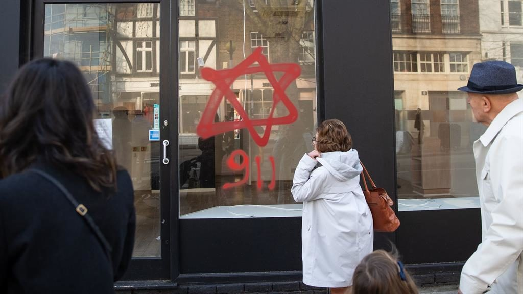 Anti-Semitic: Graffiti on a shop window in Belsize Park, north London PICTURE: PA