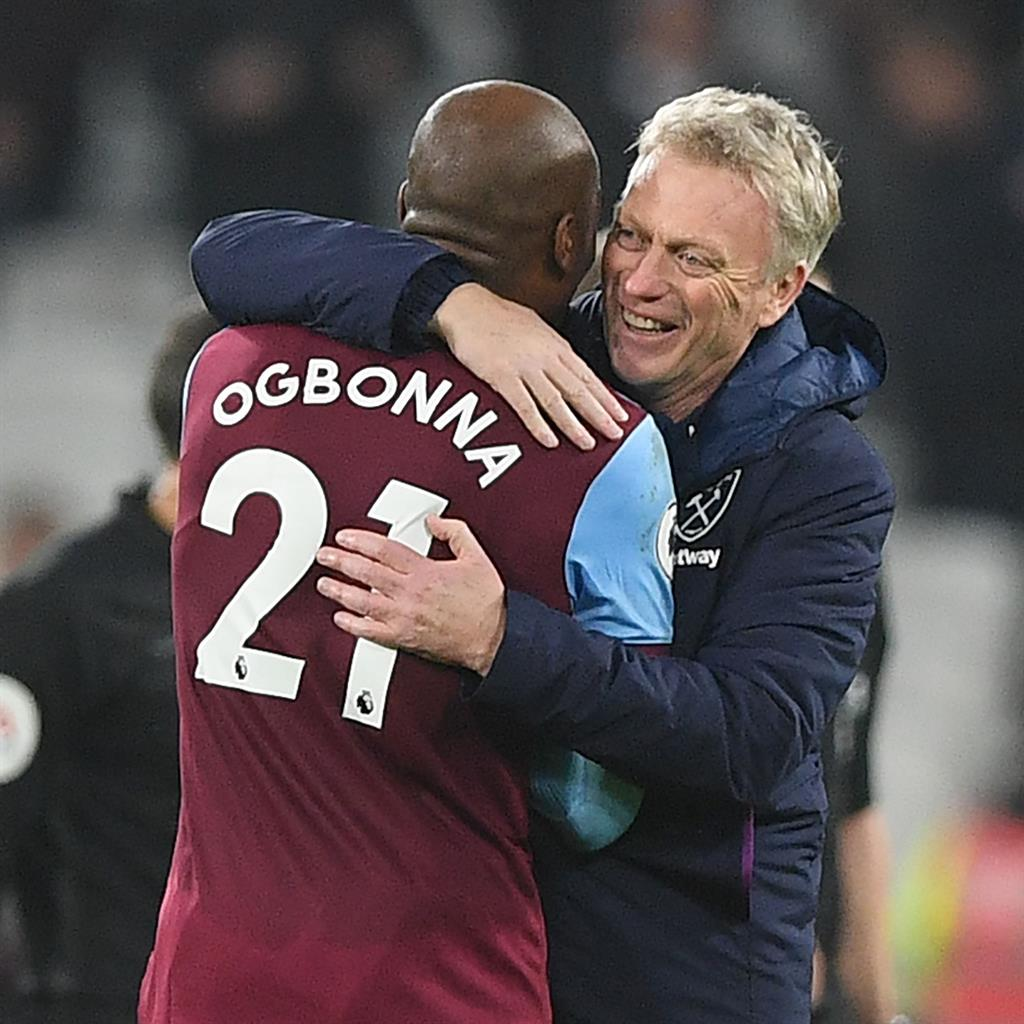 Happy returns: Moyes celebrates the win with defender Angelo Ogbonna