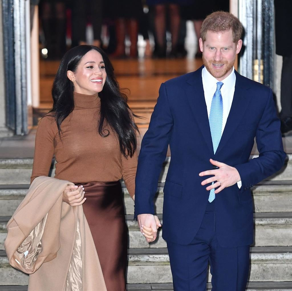 No holiday blues here: Harry and Meghan were all smiles as they carried out their first royal engagement of the decade PICTURE: TIM ROOKE/REX