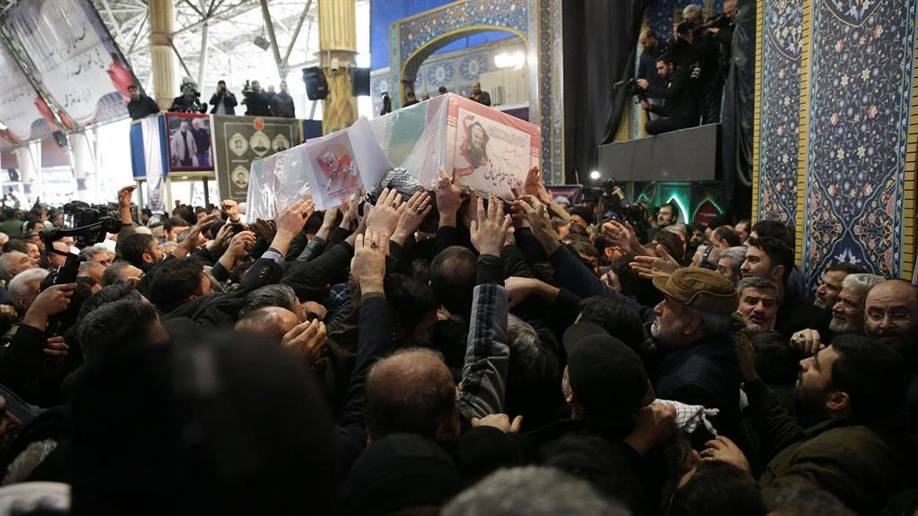 Overcrowded: Mourners reach for Soleimani's coffin yesterday PICTURE: ABACA/PA