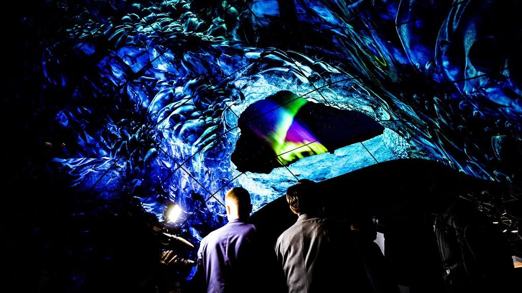 Dazzling: Visitors walk through a tunnel made of LG's OLED flexible screens at this year's CES