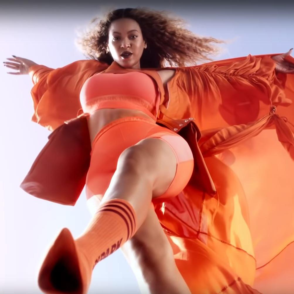 Orange crush: Beyoncé in a string of poses for adidas x IVY PARK
