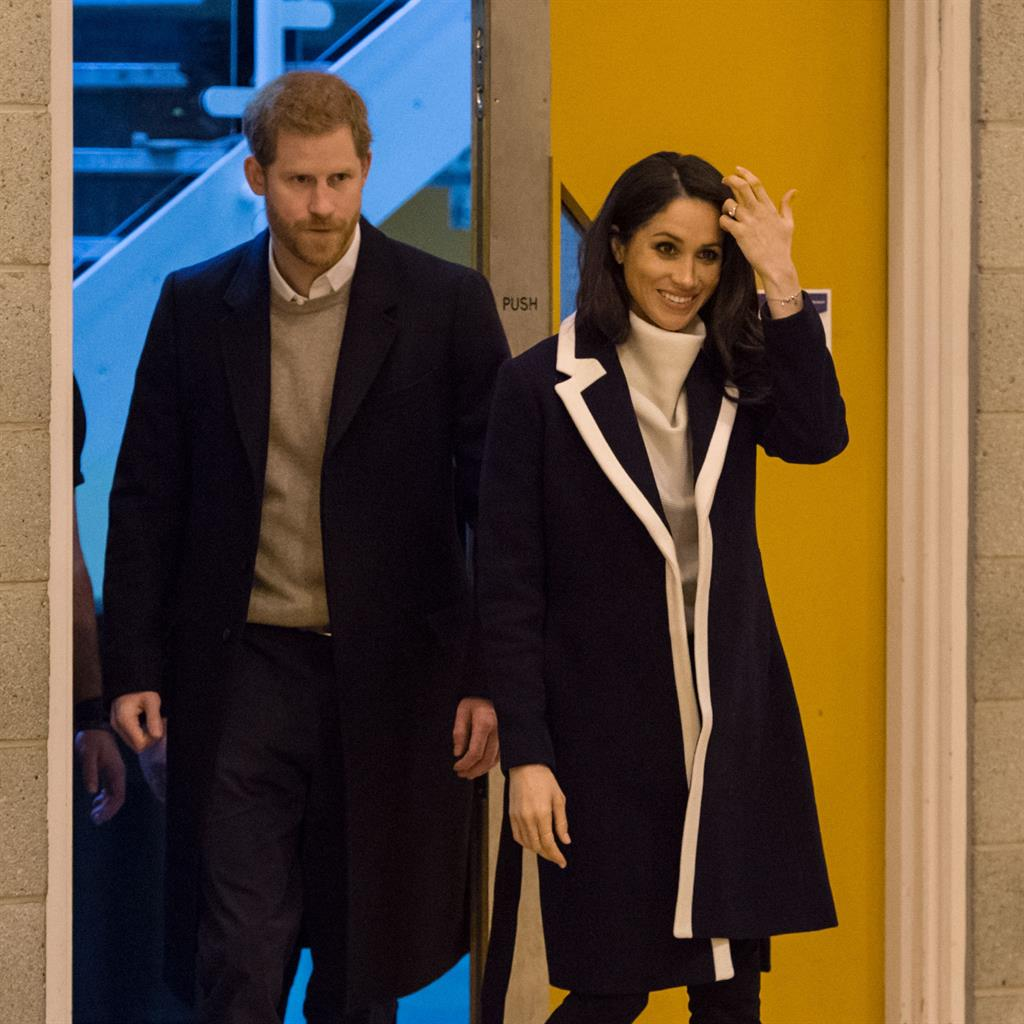 'Cashing in': Harry and Meghan want to earn, and step back from duties like this visit to Birmingham trainees in 2018 PICTURE: PA