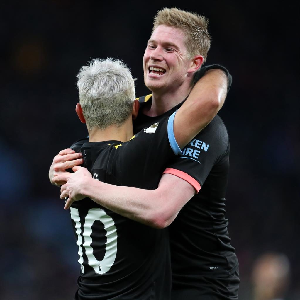 Partnership: Aguero celebrates after he scores his side's fifth goal with De Bruyne