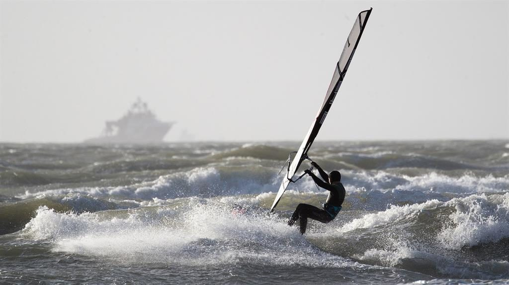 Rough going: A windsurfer braves the waves off West Wittering in West Sussex PICTURE: PA