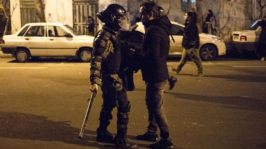 Stand off: A demonstrator is confronted in Tehran PICTURE: GETTY