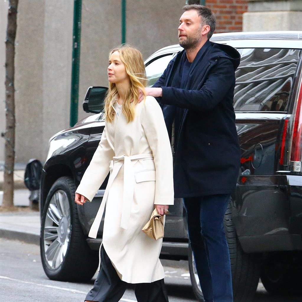 Rubbing along together: J-Law with new hubby Cooke massaging her shoulder in NYC PICTURE: SPLASH NEWS