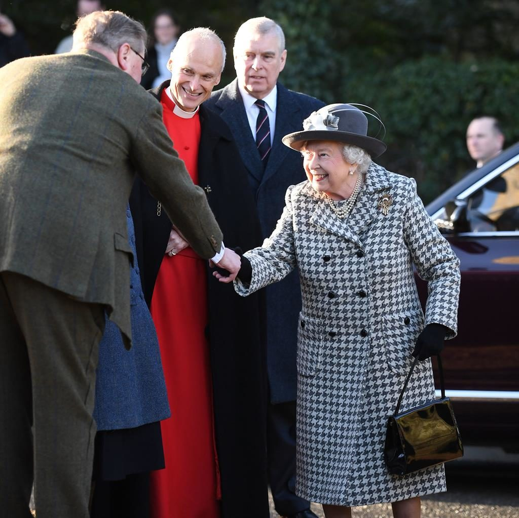 Quiet return: Prince Andrew looks on as the Queen greets wellwishers at church at Sandringham PICTURE: PA