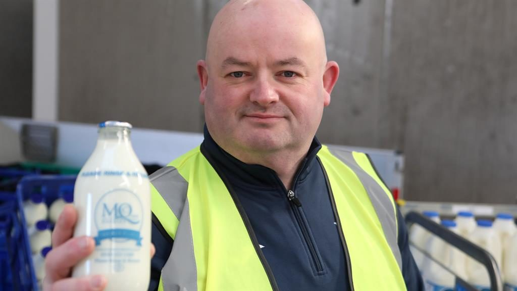 Bright and early: Galashiels milkman Jim Giblin works for McQueen's Dairies, which is seeing a growing demand for glass bottles PICTURES: SWNS