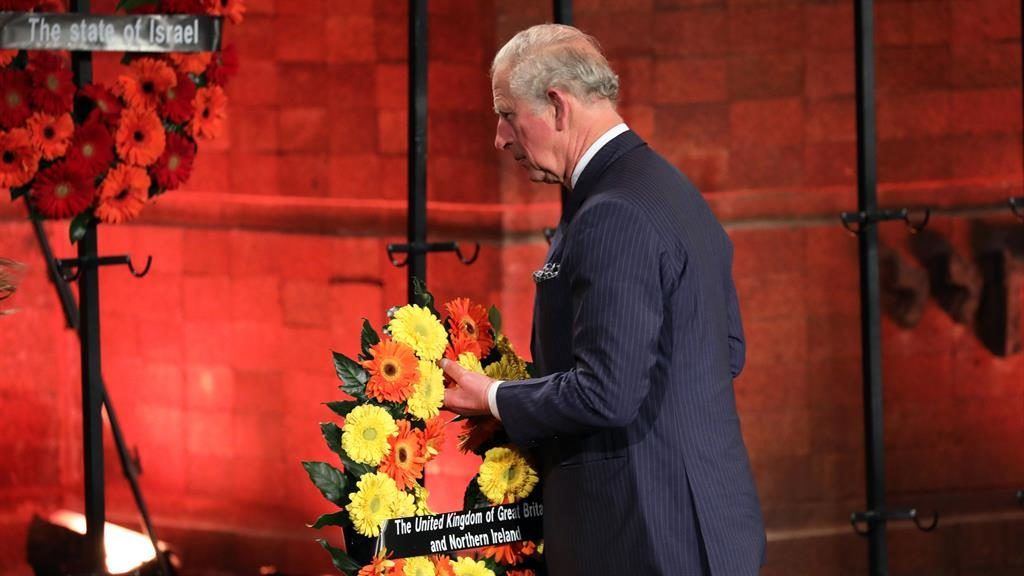 Remembrance: Charles lays a wreath at the event in Israel marking 75 years since the liberation of Auschwitz PICTURE: AFP/GETTY