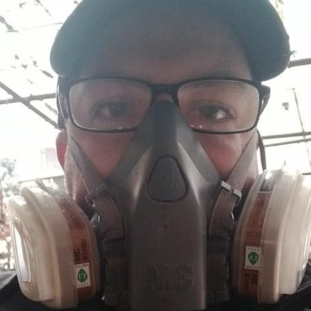 Desperate measures: Brit Chris Hill, 38, a language coach in Wuhan, wearing a gas mask he bought online