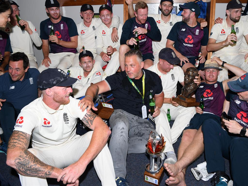 Team spirit Stokes celebrates with ex England pace bowler Darren Gough