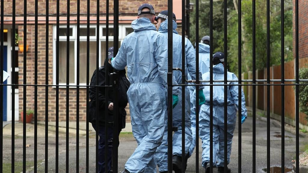 Search: Police enter Streatham bail hostel where Amman had been staying after his release from prison PICTURE : YUI MOK/PA