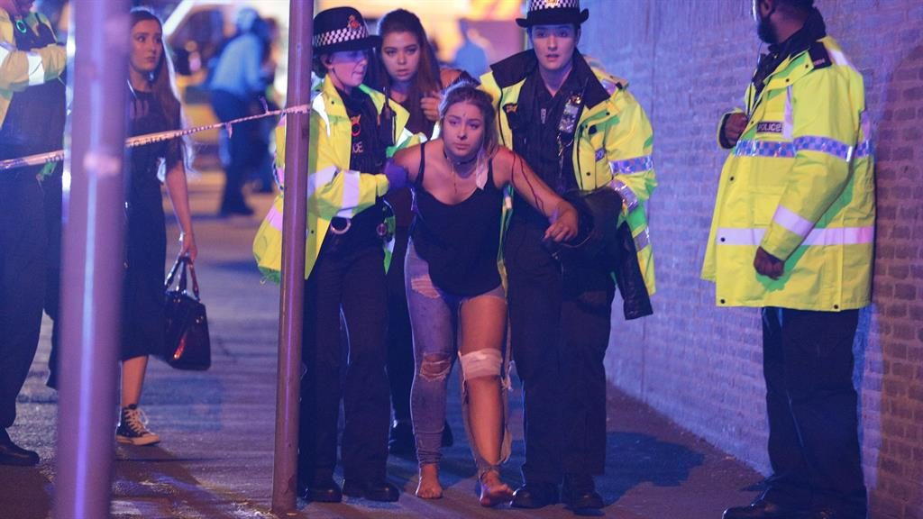 'Lethal shrapnel': An injured victim is helped after bomb attack 'designed to kill and maim as many people as possible' PICTURE: LNP