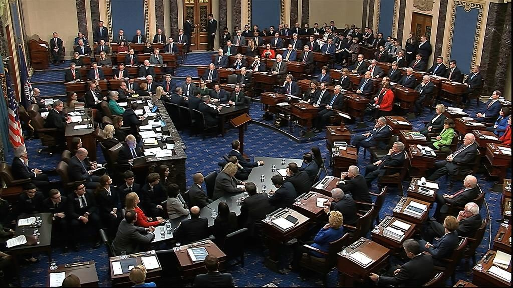 Crucial votes: Senators last night after the speech by Mitt Romney (below) PICTURE: SENATE TV