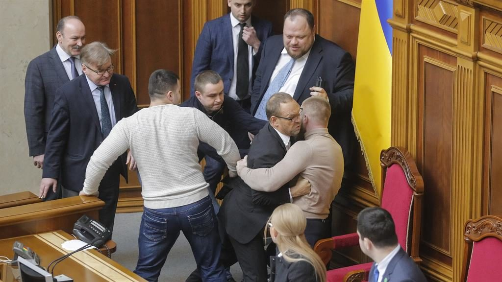 Rough and tumble: Ugly scenes as a politician is blocked from the podium in the Ukraine parliament yesterday PICTURE: EPA