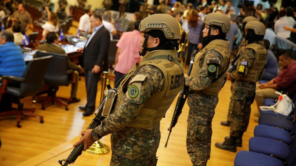 Loan rangers: Soldiers watch over politicians in El Salvador's parliament PICTURE: EPA